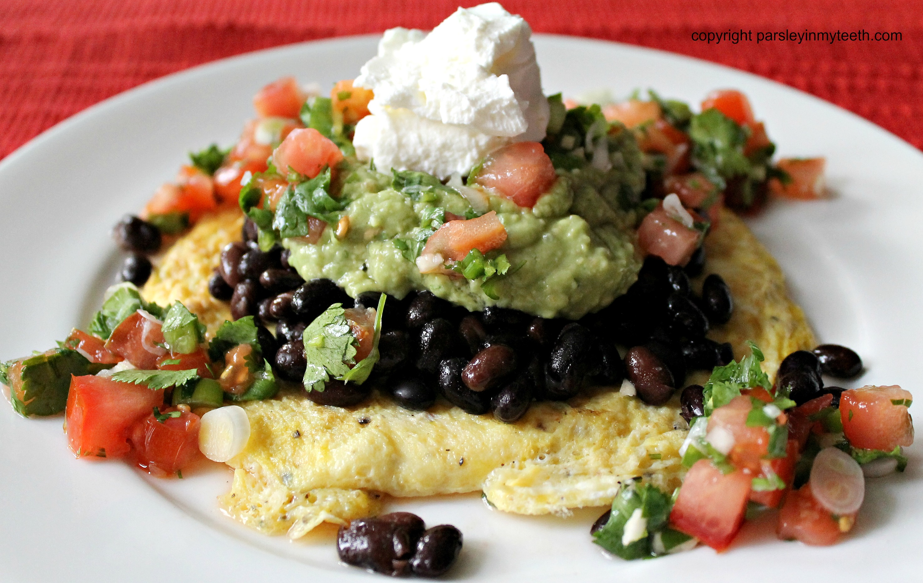 Mexican Breakfast with Eggs Black Beans Guacamole Pico de Gallo and ...