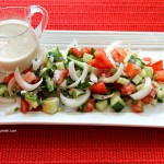 Tomato Cucumber Salad with Onions Parsley and Tahini Dressing