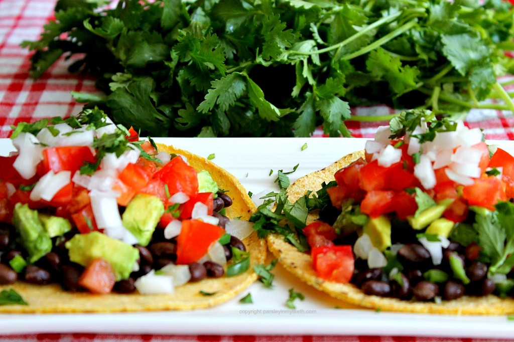 Top with a sprinkle of onions and cilantro. Squeeze a wedge of lime ...