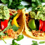 Tofu Tacos with Grilled Onions, Peppers, Arugula & Guacamole
