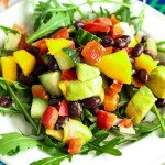 Mango Avocado Salad with Red Pepper Black Beans Cucumber & Lime over Arugula
