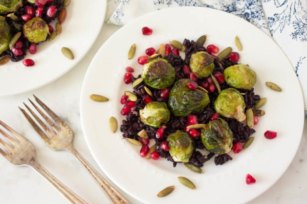 Roasted Brussels Sprouts Over Miso-Black Rice With Pomegranate & Toasted Pumpkin Seeds by Parsley In My Teeth, healthy holiday side dishes, vegan holiday side dishes