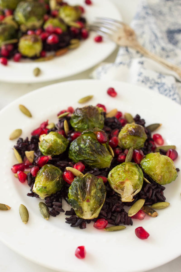 roasted-brussels-sprouts-over-miso-black-rice-with-pomegranate-toasted-pumpkin-seeds-from-parsley-in-my-teeth
